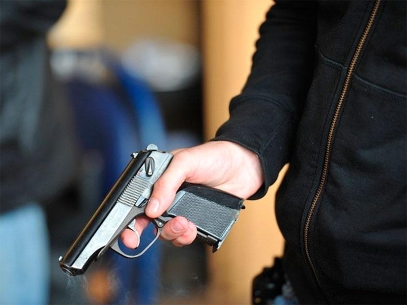 Херсонский студент выстрелил кредитору в лицо